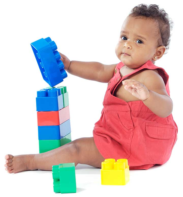 baby girl playing with blocks